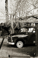 Black and white photo of 1958 Chevy pickup at old ranch in Mohave desert