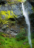 Elowah Falls in Columbia River Gorge Oregon is blown sideways by strong winds