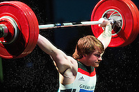 10 MAY 2014 - COVENTRY, GBR - Jack Oliver from the Paul Furness School of Weightlifting attempts to hold a lift during the men's 77kg A category round at the British 2014 Senior Weightlifting Championships and final 2014 Commonwealth Games qualifying event round at the Ricoh Arena in Coventry, Great Britain. Oliver's combined total for the event of 312kg, 32kg over the qualifying standard, makes him eligible for selection for the England team for the Commonwealth Games in Glasgow (PHOTO COPYRIGHT © 2014 NIGEL FARROW, ALL RIGHTS RESERVED)