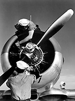 Mechanics check engine of SNJ at Kingsville Field, NATC, Corpus Christi, Texas.  November 1942.  Lt. Comdr. Charles Fenno Jacobs.  (Navy)<br /> Exact Date Shot Unknown<br /> NARA FILE #:  080-G-475186<br /> WAR & CONFLICT BOOK #:  836