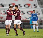 Robbie Muirhead celebrates his goal for Hearts with Arnaud Djoum