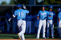 AZL Royals Edickson Soto (19) celebrates before crossing home plate after hitting a grand slam during an Arizona League game against the AZL Brewers Blue at Surprise Stadium on June 18, 2019 in Surprise, Arizona. AZL Royals defeated AZL Brewers Blue 12-7. (Zachary Lucy/Four Seam Images)