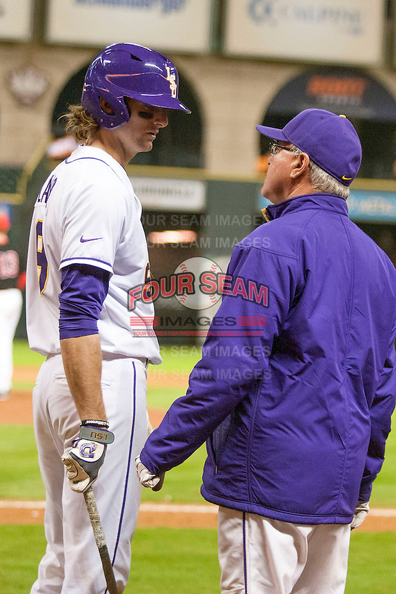LSU Tigers outfielder Mark Laird (9) talks with Head Coach Paul Mainieri (1) from the on deck circle during the NCAA baseball game against the Houston Cougars on March 6, 2015 at Minute Maid Park in Houston, Texas. LSU defeated Houston 4-2. (Andrew Woolley/Four Seam Images)