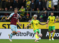 2nd October 2021;  Turf Moor, Burnley, Lancashire, England; Premier League football, Burnley versus Norwich City: Matthias Normann of Norwich City clears the ball as Chris Wood of Burnley chases