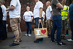 © Joel Goodman - 07973 332324 . 26/06/2017 . Manchester , UK . Fire-fighters wearing symbolic Manchester bee t-shirts walk from Manchester Central Fire Station to St Ann's Square in Manchester City Centre for a short ceremony and release of 22 doves , in commemoration of the 22 people killed in a murderous terrorist attack , carried out by Salman Abedi , following an Arina Grande concert at the Manchester Arena , on 22nd May 2017 . Local fire crews have expressed frustration after they were held back from attending to support other emergency services for nearly two hours after the bombing , on the night of the attack . Photo credit : Joel Goodman