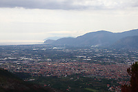 Fondi: The town and its plain, characterized by quite a lot of small lakes, that broadens to the sea, betweens Sperlonga towards the South and Terracina towards to North. The panoramic photo is taken from a mountain that belongs to the Monti Aurunci Natural Park. One can distinguish, on the right, the cliff on the sea of Pisco Montano, behind which is  Monte Sant'Angelo, where is located Terracina. Once more on the right, on the background, in the distance, there is the profile of the Monte Circeo, too. This is a slight enlargement of a part of the original image.