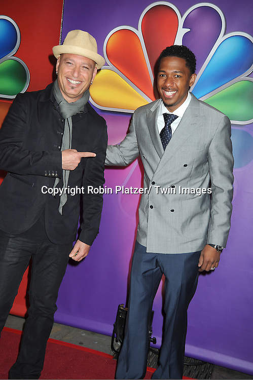 Howie Mandel and Nick Cannon attends the NBC Upfront Presentation of 2012-2013 Season at Radio City Music Hall on May 14, 2012 in New York City.