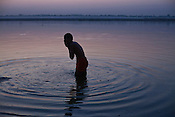 A Hindu devotee bathes at dawn on the ghats of Ganges in the ancient city of Varanasi in Uttar Pradesh, India. Photograph: Sanjit Das/Panos
