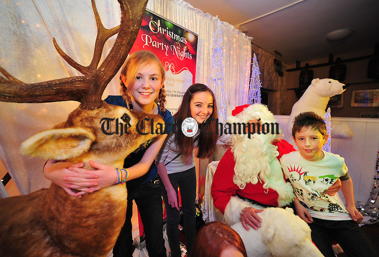 Allie Lowry with Ciara and Brian Mooney at the launch of the West County Hotel/Clare Inn's Christmas party season at the West County Hotel, Ennis. Photograph by Declan Monaghan