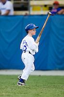 The Burlington Royals bat boy in action at Burlington Athletic Park in Burlington, NC, Sunday, August 26, 2007.