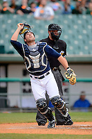 New Orleans Zephyrs catcher Jake Jefferies #8 looks for a pop up in front of umpire Angel Campos during a game against the Round Rock Express on April 15, 2013 at Zephyr Field in New Orleans, Louisiana.  New Orleans defeated Round Rock 3-2.  (Mike Janes/Four Seam Images)