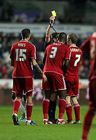 Saturday, 12 December 2012<br /> Pictured: Grant Leadbitter of Middlesbrough (R) sees a yellow card by match referee Lee Probert for his foul against Michu of Swansea (not pictured)<br /> Re: Capital One Cup, fifth round, Swansea City FC v Middlesbrough at the Liberty Stadium, south Wales.