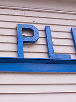Painted wooden letters on wooden exterior<br />