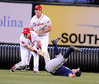 Members of the Rome Braves and Greenville Drive stage a mock battle, attacking from opposite sides of the field, during a lengthy rain delay before a game on July 5, 2012, at Fluor Field at the West End in Greenville, South Carolina. (Tom Priddy/Four Seam Images)
