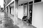 Council Estate Housing. Young mother with pram leaving her flat Hoxton east London 1978.<br /> <br /> my ref 35/3518/, 1978,