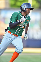 Greensboro Grasshoppers left fielder Thomas Jones (12) runs to first base during a game against the Asheville Tourists at McCormick Field on May 10, 2018 in Asheville, North Carolina. The Tourists defeated the Grasshoppers 14-10. (Tony Farlow/Four Seam Images)