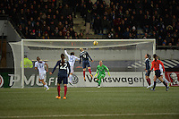 Lorient, France. - Sunday, February 8, 2015:  Eugénie LE Sommer (9) of France scores the game winning goal beating Meghan Klingenberg (25) and goalkeeper Ashlyn Harris (24) of the USWNT. France defeated the USWNT 2-0 during an international friendly at the Stade du Moustoir.
