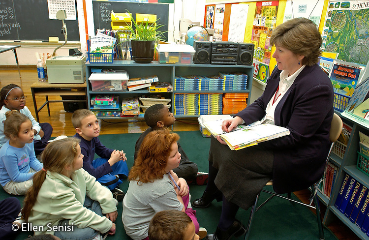 MR / Schenectady, NY.Yates Arts-in-Education Magnet School, Grade 2.Arts-Themed Urban Elementary School.Teacher teaches reading lesson using teacher's edition of reading book series..MR: Car19   g2c.© Ellen B. Senisi