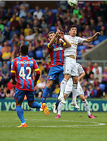 Pictured: Mile Jedinak of Crystal Palace battles for a header against Jack Cork of Swansea<br /> Re: Premier League match between Crystal Palace and Swansea City at Selhurst Park on Sunday 24 May 2015 in London, England, UK