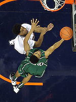 CHARLOTTESVILLE, VA- NOVEMBER 26:  Keifer Sykes #24 of the Green Bay Phoenix shoots next to Jontel Evans #1 of the Virginia Cavaliers during the game on November 26, 2011 at the John Paul Jones Arena in Charlottesville, Virginia. Virginia defeated Green Bay 68-42. (Photo by Andrew Shurtleff/Getty Images) *** Local Caption *** Jontel Evans;Keifer Sykes