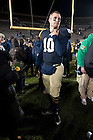 November 19, 2011; Quarterback Dayne Crist comes out to greet his parents on the field after Notre Dame defeated Boston College 16-14 on Senior Day. Photo by Barbara Johnston/University of Notre Dame.