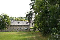 The chateau is situated in an idyllic setting of trees within its own park