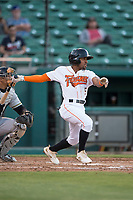 Fresno Grizzlies second baseman Tony Kemp (5) follows through on his swing during a Pacific Coast League game against the Salt Lake Bees at Chukchansi Park on May 14, 2018 in Fresno, California. Fresno defeated Salt Lake 4-3. (Zachary Lucy/Four Seam Images)