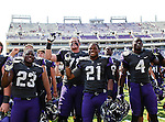 TCU Horned Frogs running back B.J. Catalon (23), TCU Horned Frogs safety Zach Jackson (21) and TCU Horned Frogs safety Jordan Moore (4) celebrate after the game between the Virginia Cavaliers and the TCU Horned Frogs  at the Amon G. Carter Stadium in Fort Worth, Texas. TCU defeats Virginia 27 to 7....