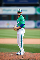 Hartford Yard Goats relief pitcher Marc Magliaro (14) gets ready to deliver a pitch during a game against the Trenton Thunder on August 26, 2018 at Dunkin' Donuts Park in Hartford, Connecticut.  Trenton defeated Hartford 8-3.  (Mike Janes/Four Seam Images)