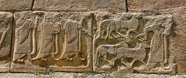 Pictures & Images Hittite relief sculpted orthostat panels of the Sphinx Gate. Left panel depicts a procession following (right) a man leading goats to be sacrificed.  Alaca Hoyuk (Alacahoyuk) Hittite archaeological site  Alaca, Çorum Province, Turkey, Also known as Alacahüyük, Aladja-Hoyuk, Euyuk, or Evuk