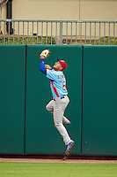 Tennessee Smokies outfielder Albert Almora (6) jumps at the wall attempting to catch a home run during a game against the Montgomery Biscuits on May 25, 2015 at Riverwalk Stadium in Montgomery, Alabama.  Tennessee defeated Montgomery 6-3 as the game was called after eight innings due to rain.  (Mike Janes/Four Seam Images)