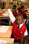 Parochial School Bronx New York  Kindergarten boy with hand raised vertical