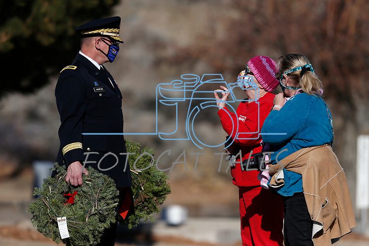 Nevada National Guard Brigadier General Michael Hanifan talks with Navy veteran Phyllis Adams, center, and Pam Sheldon during the National Wreaths Across America Day at the Lone Mountain Cemetery, in Carson City, Nev., on Saturday, Dec. 19, 2020. The program honors veterans at more than 2100 cemeteries around the world. <br /> Photo by Cathleen Allison/Nevada Momentum Fueled by RAD