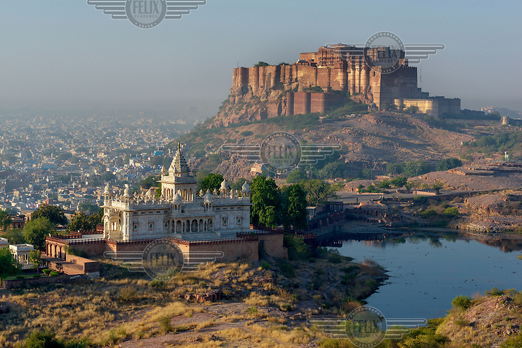 A dawn view across Jaswant Thada (the elaborately carved white marble funerary monument built in 1899 to honor Maharaja Jaswant Singh II) to the 15th century Mehrangarh Fort/Palace.