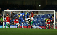 Wednesday 09 January 2013<br /> Pictured: Ben Davies of Swansea (C in red) heads the ball away while challenged mid air by Fernando Torres of Chelsea<br /> Re: Capital One Cup semifinal, Chelsea FC v Swansea City FC at the Stamford Bridge Stadium, London.