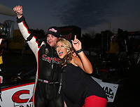 Sep 2, 2017; Clermont, IN, USA; NHRA top fuel driver Steve Torrence celebrates with Taylor Snyder after winning the Traxxas Shootout specialty race during qualifying for the US Nationals at Lucas Oil Raceway. Mandatory Credit: Mark J. Rebilas-USA TODAY Sports