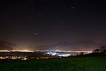 Light pollution, also known as photopollution or luminous pollution, Lichtverschmutzung über dem Rheintal, gesehen von der Strasse zwischen Eschen und Gamprin, Liechtenstein.