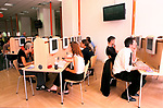 'EASYEVERYTHING INTERNET CAFE', LONDON, UK 1999. SOME OF THE 400 TERMINALS AVAILABLE IN THE VICTORIA STORE, 2000
