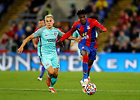 27th September 2021;  Selhurst Park, Crystal Palace, London, England; Premier League football, Crystal Palace versus Brighton & Hove Albion: Wilfried Zaha of Crystal Palace being chased by Leandro Trossard of Brighton