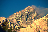 Sunset falling on the snow dusted face of Mount Everest, Nepal.