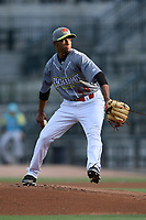 Starting pitcher Willy Taveras (40) of the Columbia Fireflies, playing as the Chicharrones de Columbia in the MiLB Copa de la Diversion program, pitches into the sun in a game against the Charleston RiverDogs on Friday, July 12, 2019 at Segra Park in Columbia, South Carolina. The RiverDogs won, 4-3, in 10 innings. (Tom Priddy/Four Seam Images)