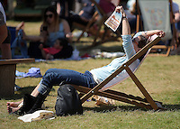 Hay on Wye. Sunday 05 June 2016<br /> A woman reads a book on the green at the Hay Festival, Hay on Wye, Wales, UK