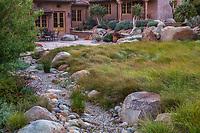 Carex sedge lawn (mix of Carex pansa, C. praegracillis and C. divulsa) with dry creek rainwater bioswale for permeability in Schaff Garden; Carpinteria California
