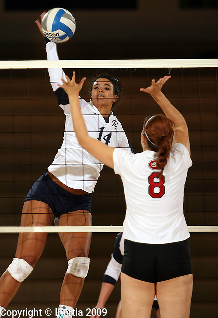 SIOUX FALLS, SD - SEPTEMBER 29:  Blythe Johnson #14 of Augustana tries for a kill past Erica Beacom #8 from St. Cloud State University in the third game of their match Tuesday night at the Elmen Center. (Photo by Dave Eggen/Inertia).