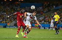Sulley Muntari of Ghana and Miroslav Klose of Germany in action