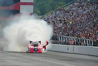 Jun. 19, 2011; Bristol, TN, USA: NHRA funny car driver Cruz Pedregon blows his engine during eliminations at the Thunder Valley Nationals at Bristol Dragway. Mandatory Credit: Mark J. Rebilas-