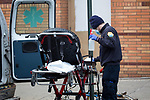 A healthcare worker disinfected a stretcher after bringing a patient to the Wyckoff Heights Medical Center during the coronavirus pandemic (COVID-19) in the Brooklyn borough of New York City on April 5, 2020.  Photograph by Michael Nagle