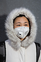 "Mrs. Huang (40), a life long Beijing resident. ""About 4-5 years ago I started using masks. I don't feel comfortable in my lungs."", she explains. ""Of course there's been a big change in the air. Since the 1980's there were sandstorms. Then it got better. Around 2000, industry got more and more and the air got bad."" PM2.5 reading - 188 - Unhealthy"