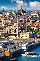 The Yeni Camii, The New Mosque or Mosque of the Valide Sultan (foreground) ordered by Safiye Sultan in 1597 on  the banks of the Golden Horn and the Galata bridge, Istanbul Turkey.