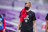 ORLANDO, FL - FEBRUARY 24: Quinn #5 of the CANWNT walks into the stadium before a game between Brazil and Canada at Exploria Stadium on February 24, 2021 in Orlando, Florida.
